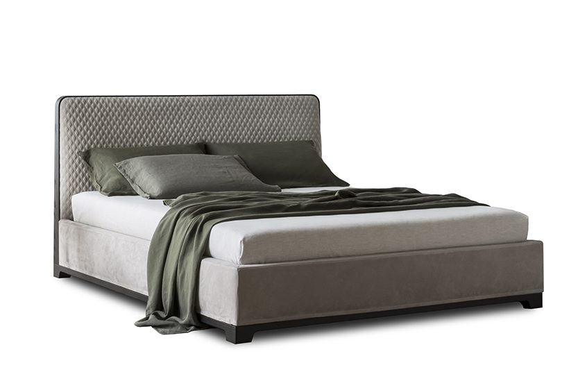 Contemporary Bedroom Furniture Design with Upholstered Starting Grade Leather framed in Walnut