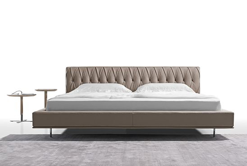 Modern Bed Frame with cushioned headboard design and raised, upholstered platform